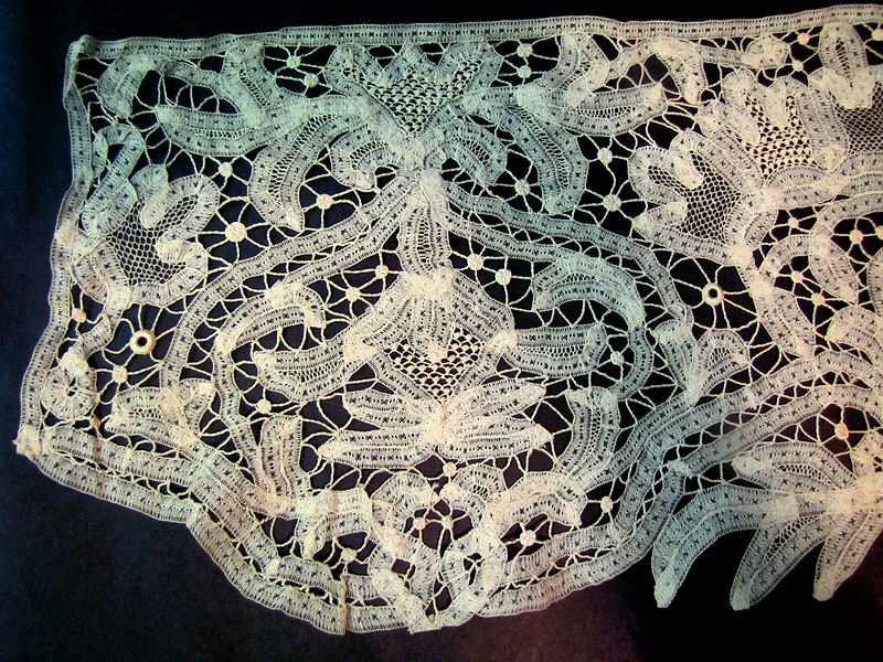 close up antique handmade tape and needle lace trim