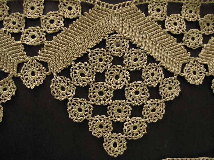 close up pair vintage handmade lace trim or ends for table runner or towel