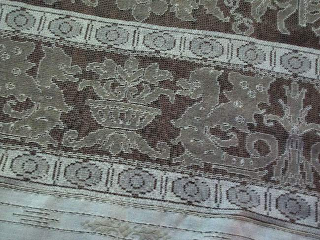 close-up figural lace of vintage tablecloth