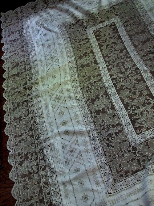 half of figural lace tablecloth