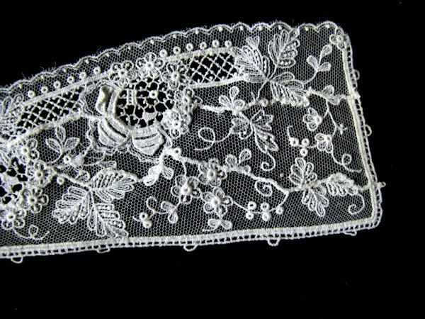 close-up jabot of antique victorian point de venise combination collar