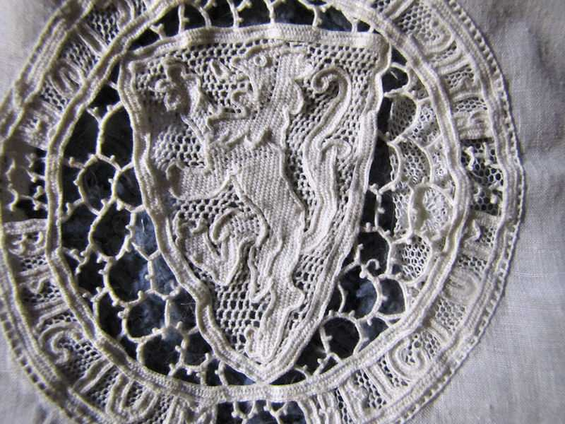 close up vintage antique handmade pillow cover figural lace