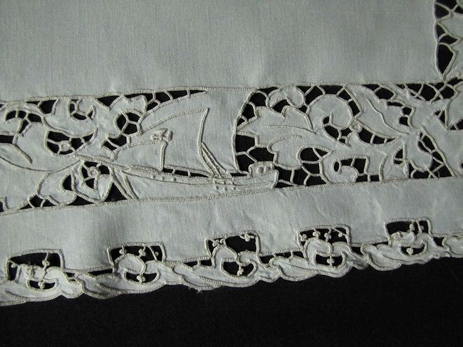 close-up boat on vintage figural lace placemat