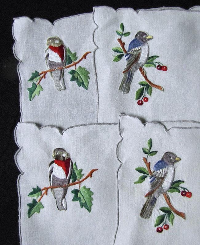 close-up 4 birds Porthault placemats