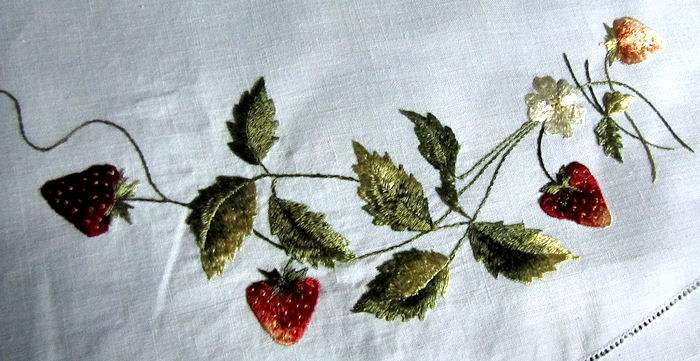 close up 2 vintage antique handmade linen table topper with lace and society silk strawberries