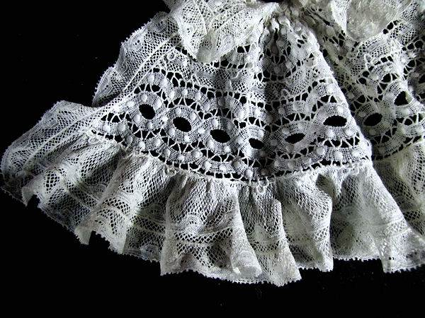 close up vintage antique lace collar and jabot