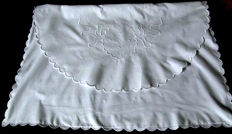 close up pair vintage envelope pillowcases hand embroidered