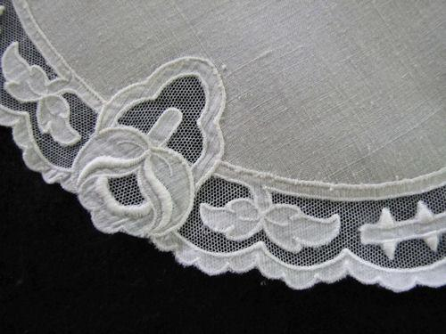close up vintage Carrickmacross lace doily