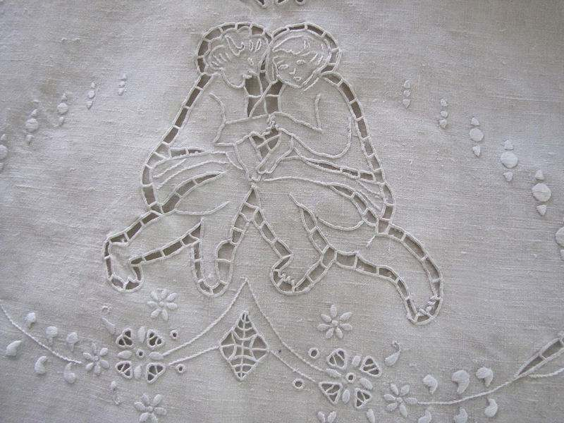 close up pair vintage antique linen pillowcases handmade figural lace and embroidery