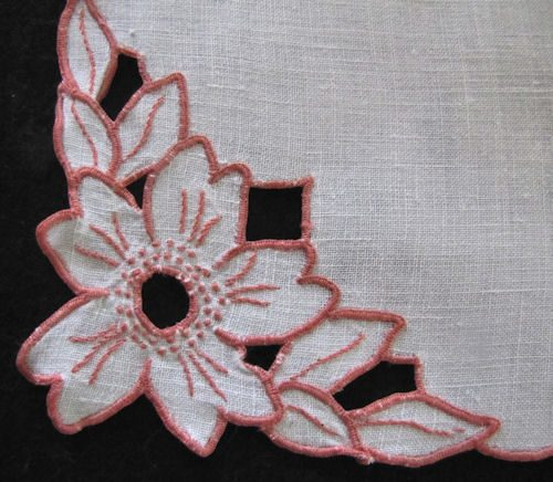 close up vintage antique linen doily with handmade cutwork lace and embroidery