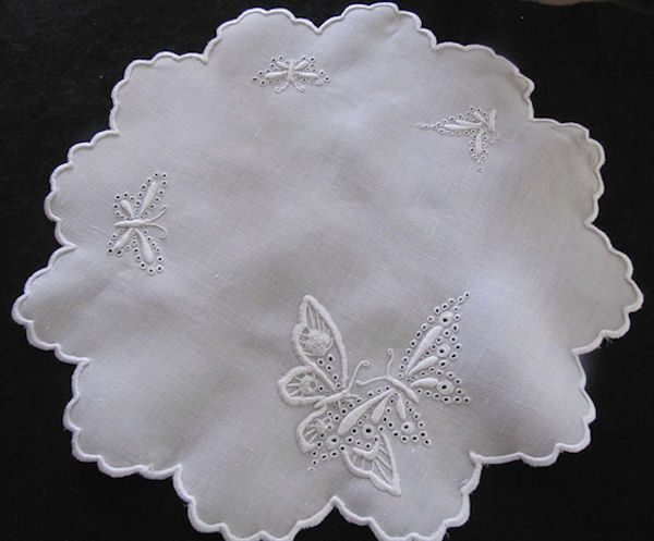 vintage antique white linen doily with handmade figural lace and whitework butterflies