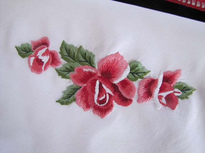 close up vintage antique Pair pillowcases hand embroidered red roses