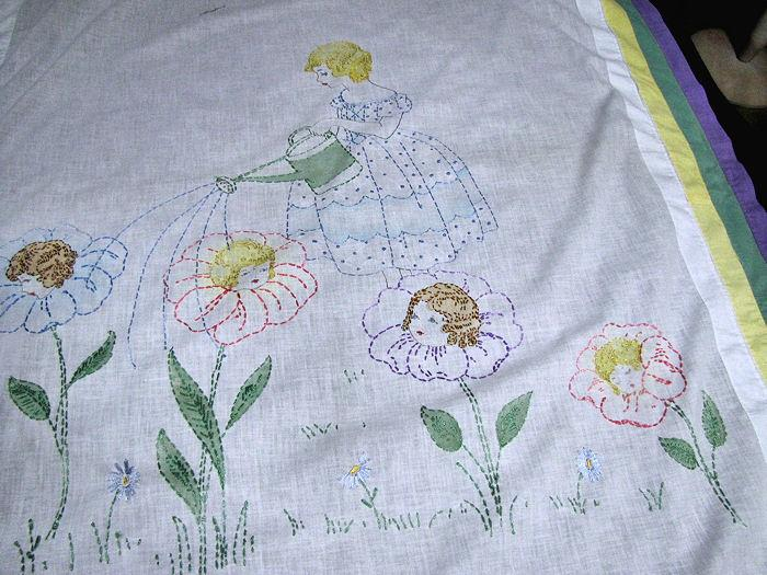 close up vintage little girl's bedspread