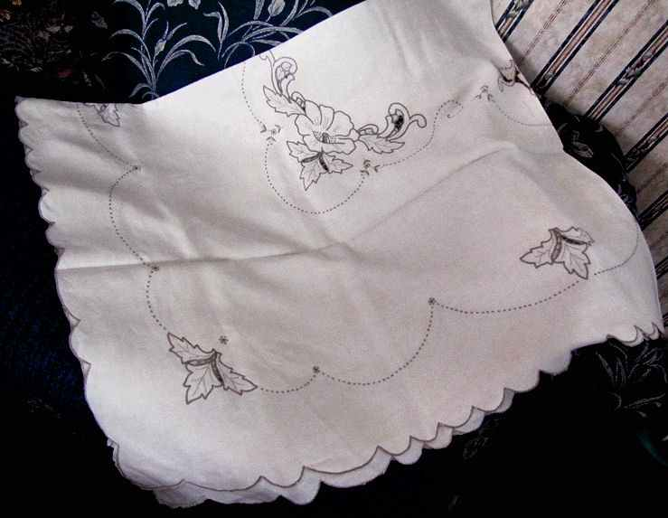 close up vintage antique handmade linen tablecloth and napkins lace and embroidery