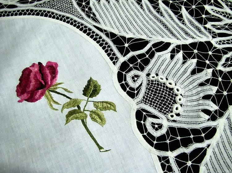 close up vintage antique table topper society silk embroidery and handmade lace
