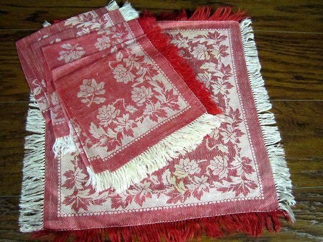 close up vintage antique turkey red fringed linen napkins