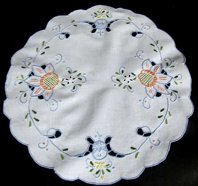 close up pair vintage antique white linen doilies handmade lace and Madeira blue embroidery