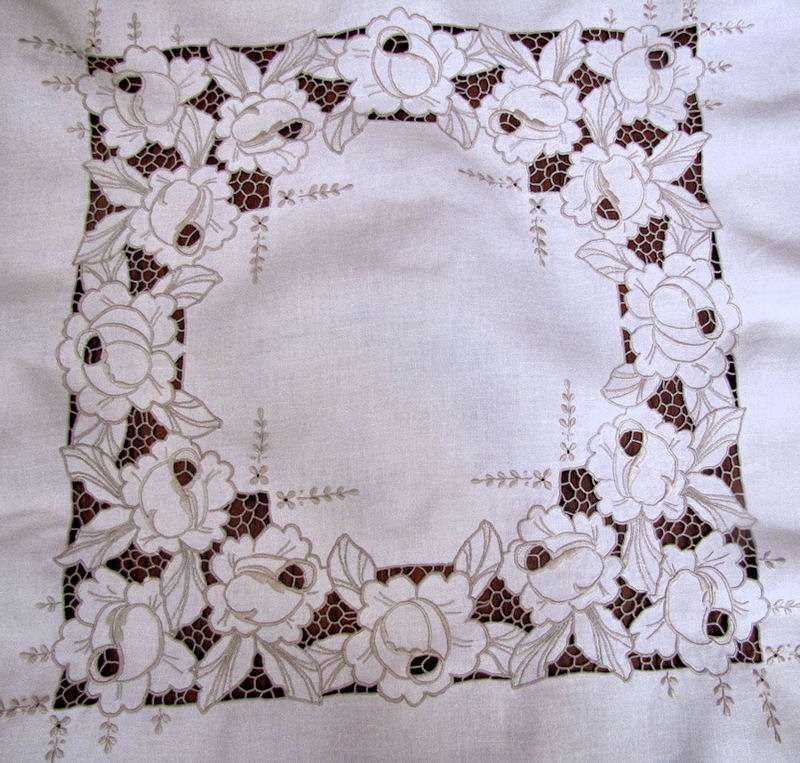 close up vintage antique tablecloth handmade lace and embroidery