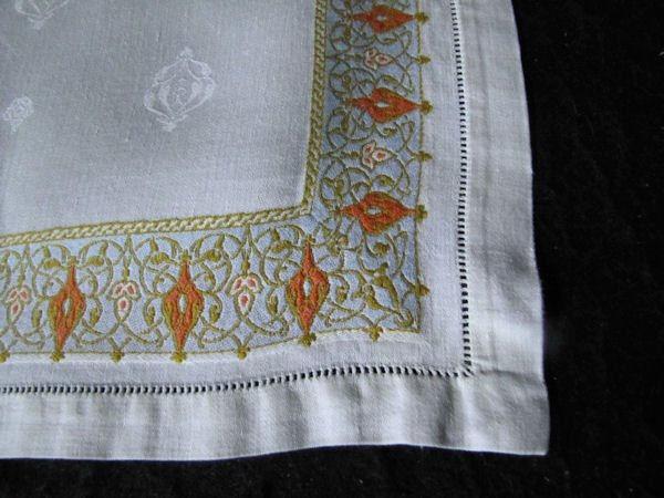 border of vintage damask linen napkins
