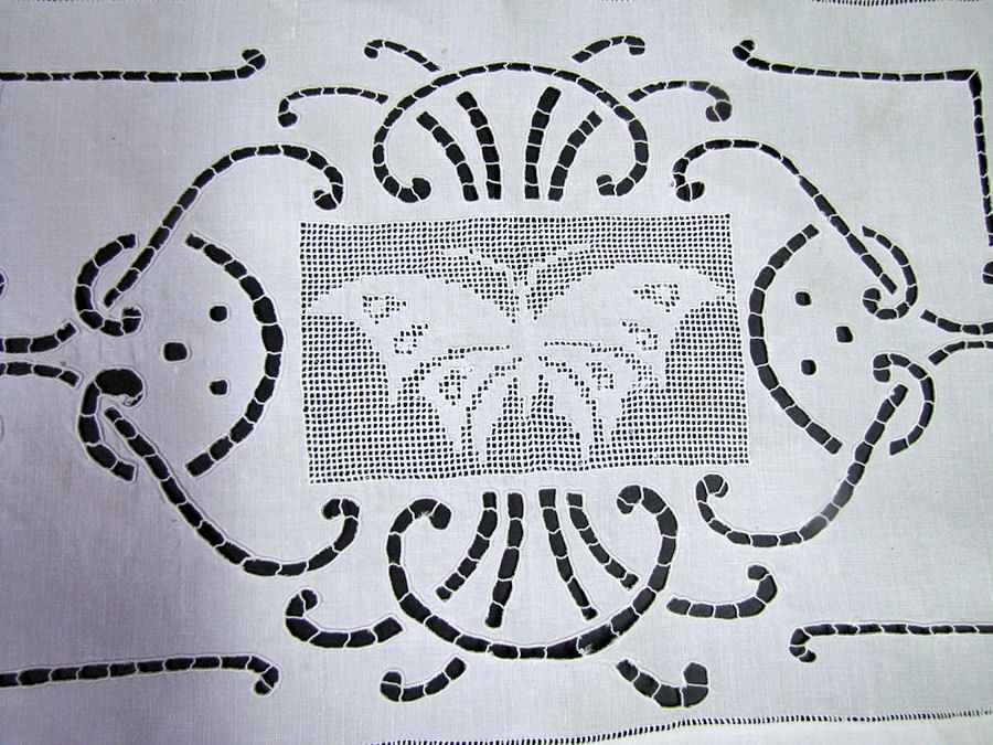 close up vintage antique table runner handmade figural lace butterfly