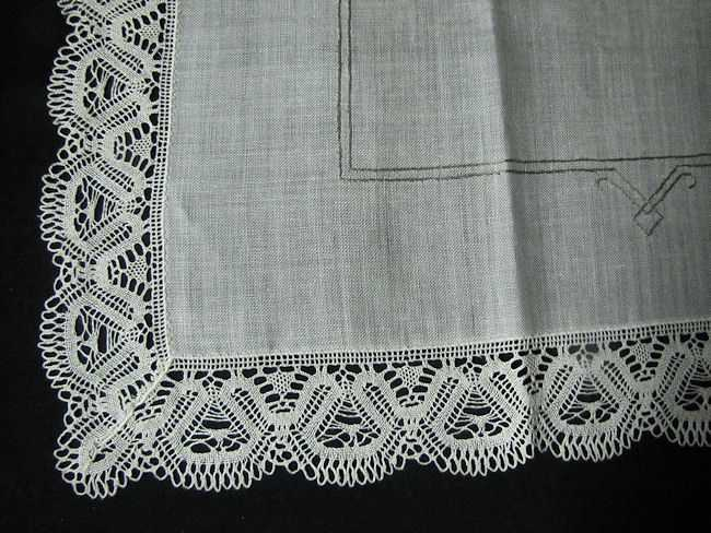 close up vintage beige linen tablecloth handmade lace and embroidery