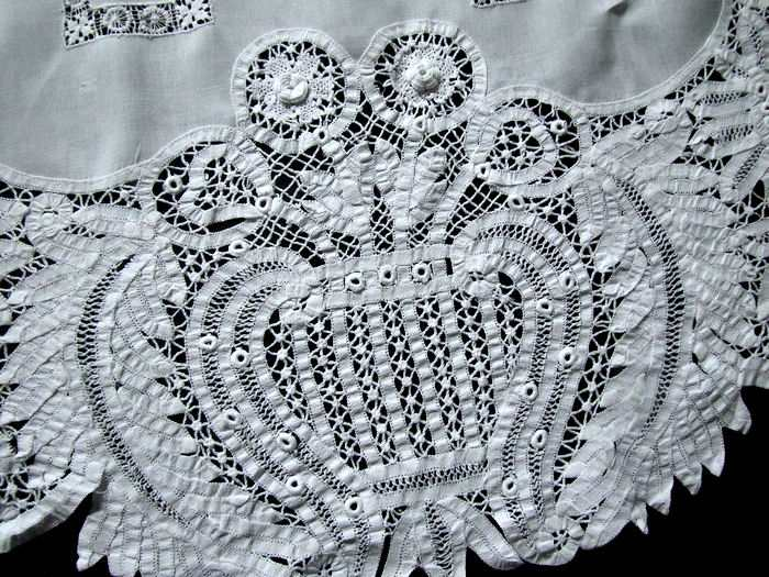 close up round vintage antique white linen tablecloth with handmade lace
