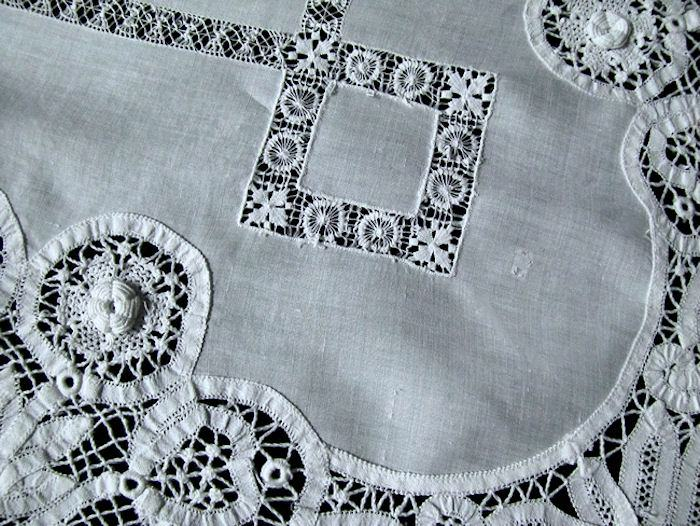 close up 3 round vintage antique white linen tablecloth with handmade lace