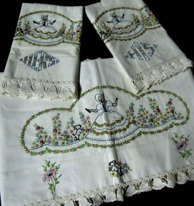 close up vintage hand embroidered sheet set with his and hers pillowcases Southern Belle