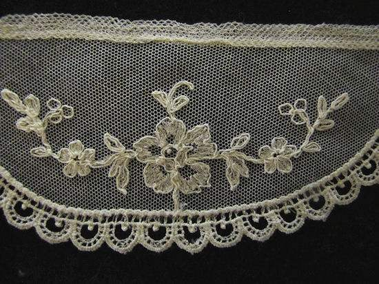 close up vintage antique Limerick lace cuffs