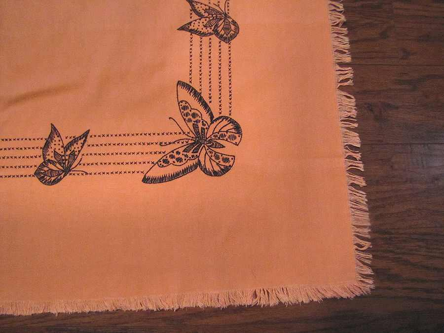 close up vintage antique linen table topper with hand embroidered butterflies