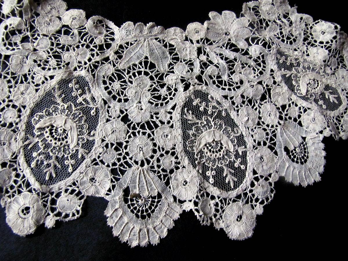 close up vintage antique handmade Brussels lace with point de venise