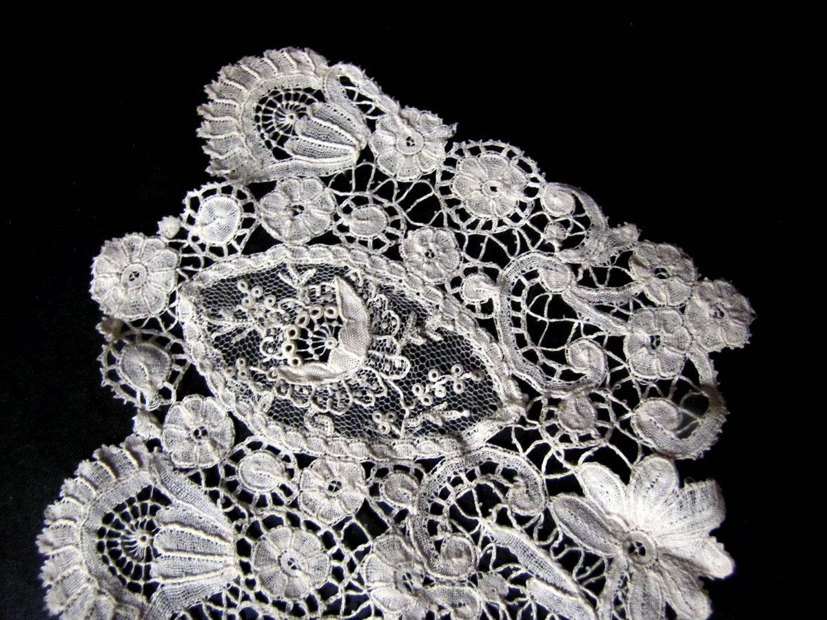 close up 3 vintage antique handmade Brussels lace with point de venise