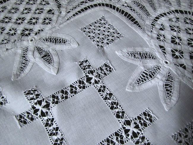 close up handmade lace on white linen vintage table topper