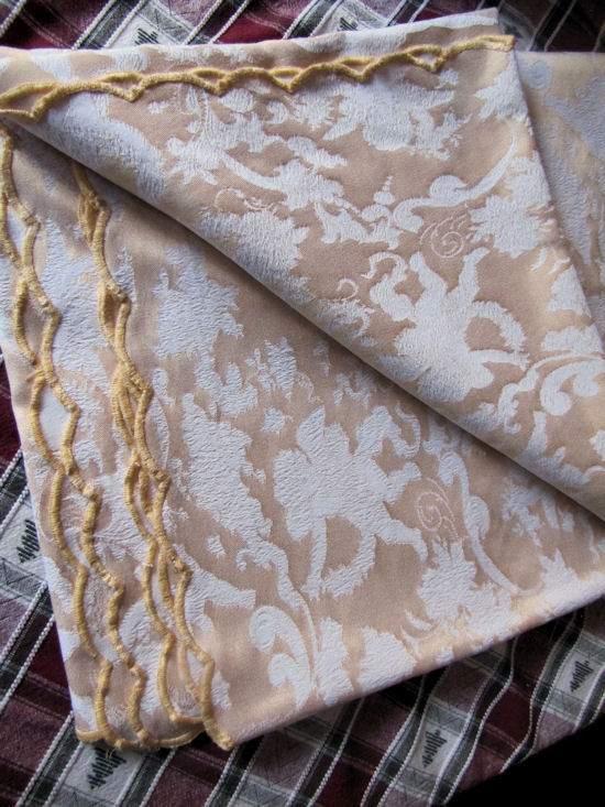 folded figural damask tablecloth