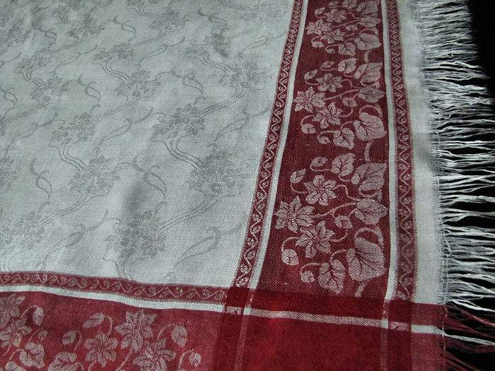 close up vintage Turkey red and white linen fringed table topper