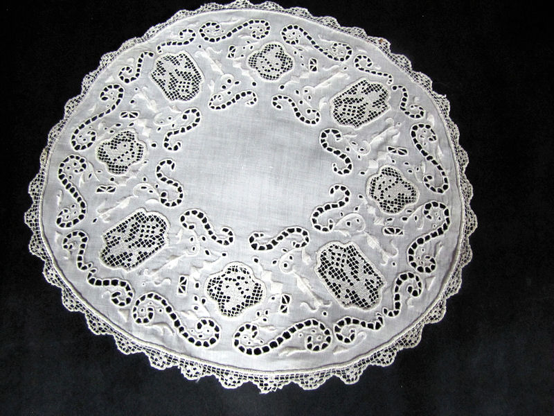 vintage antique handmade doily with figural lace and whitework