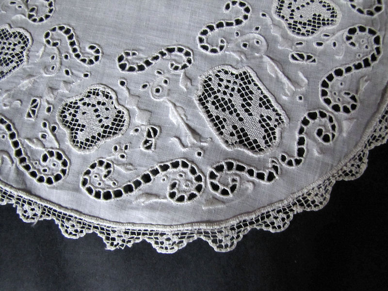 close upvintage antique handmade doily with figural lace and whitework