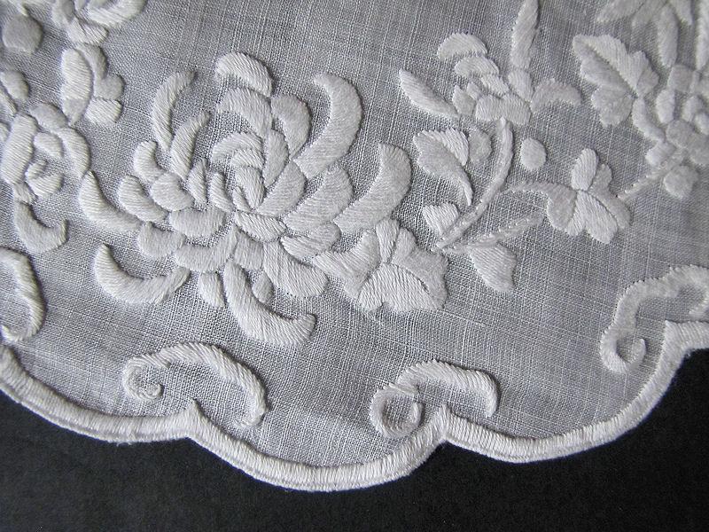 close up vintage antique pair whitework doilies