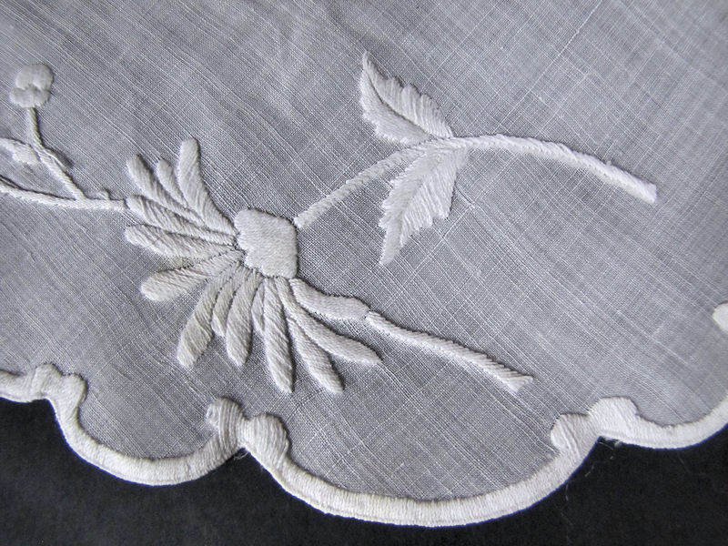 close up vintage handmade whitework doily
