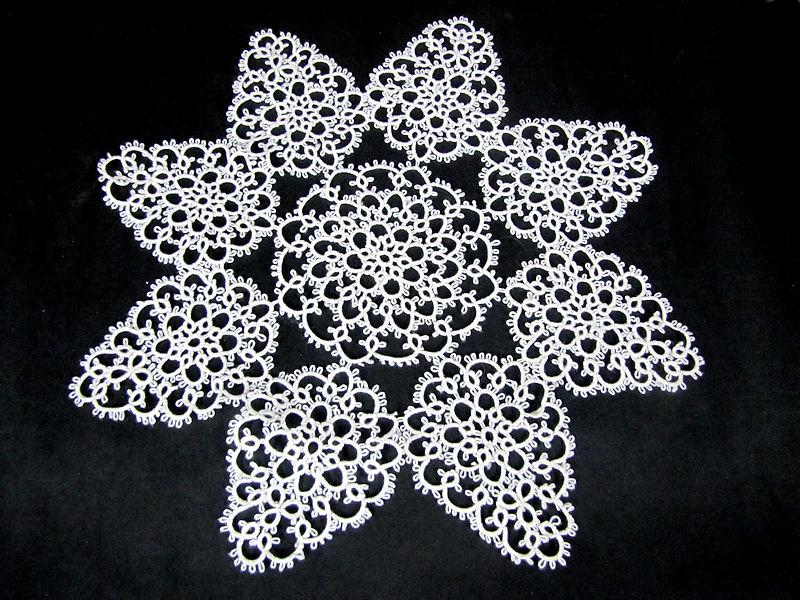 close up pair vintage handmade lace doilies