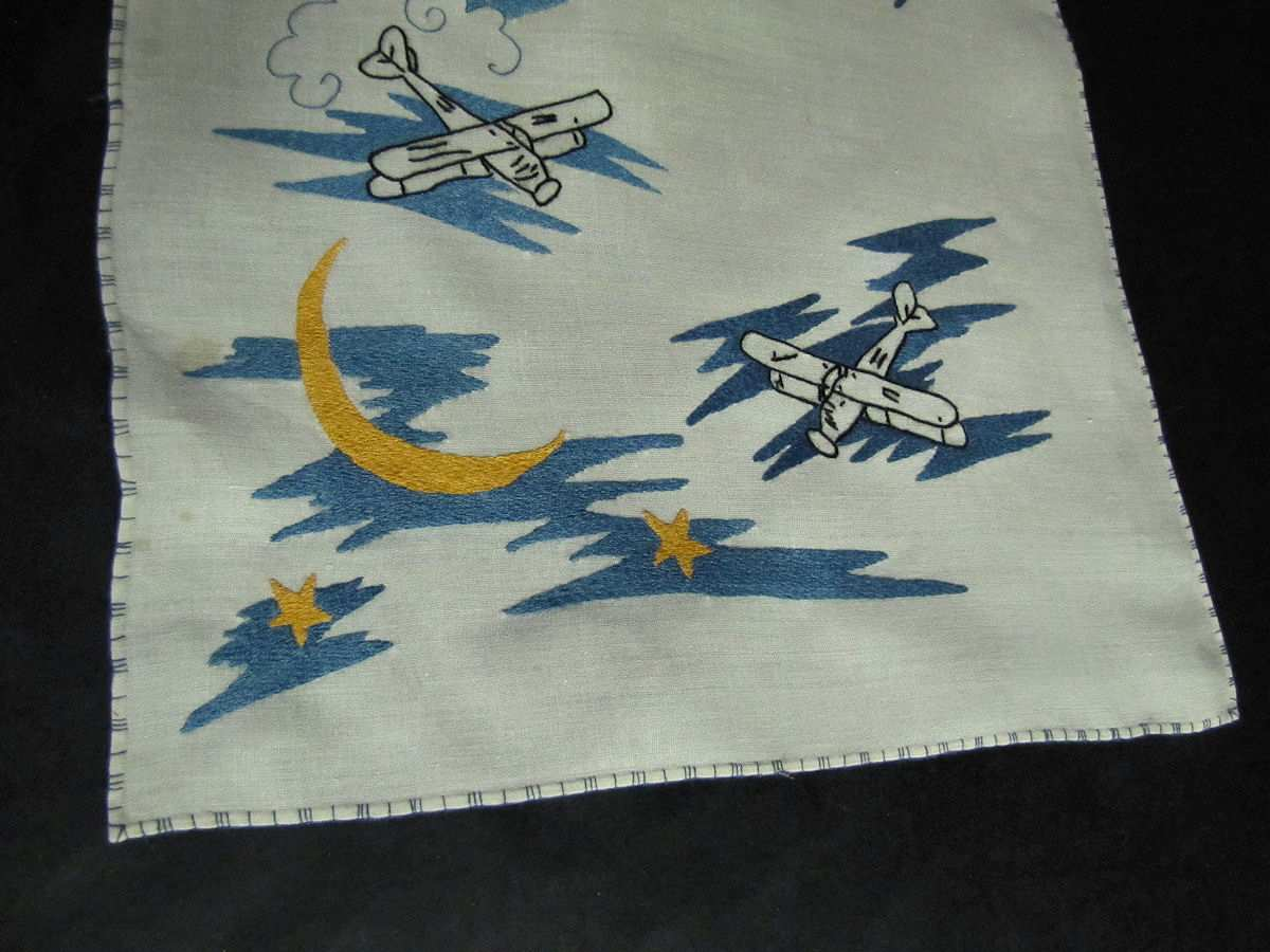 close up vintage antique placemats set hand embroidered biplanes