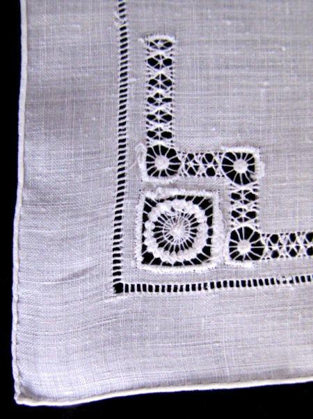 close up needle lace on vintage handmade whitework hanky