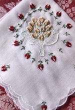 vintage hanky with embroidered rosebuds and gift pocket