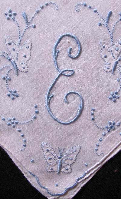 close up vintage handmade monogrammed E hanky with Butterflies