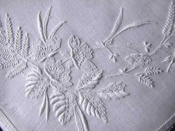 close up vintage handmade whitework hanky embroidered ferns and flowers