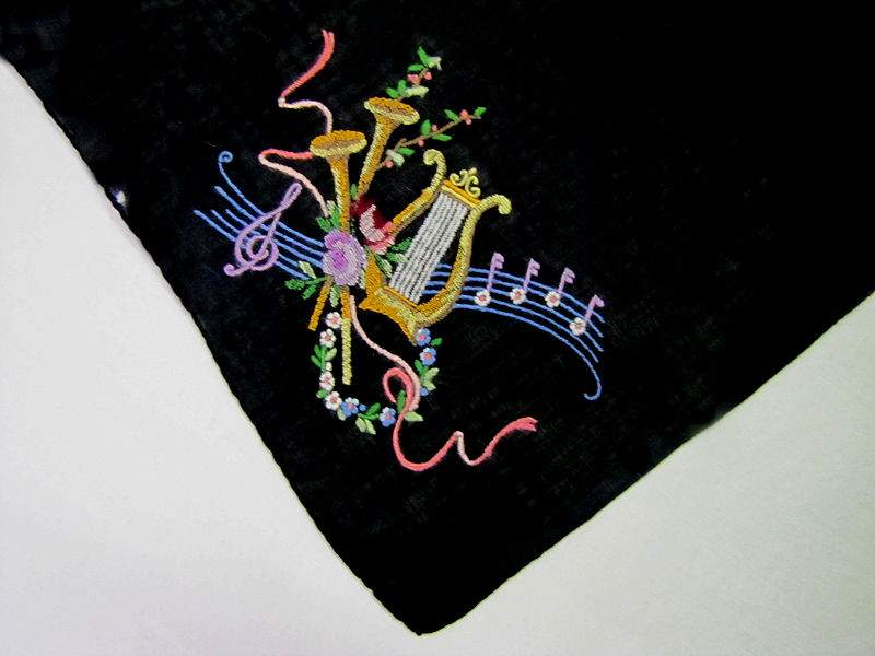close up vintage antique embroidered black music hanky
