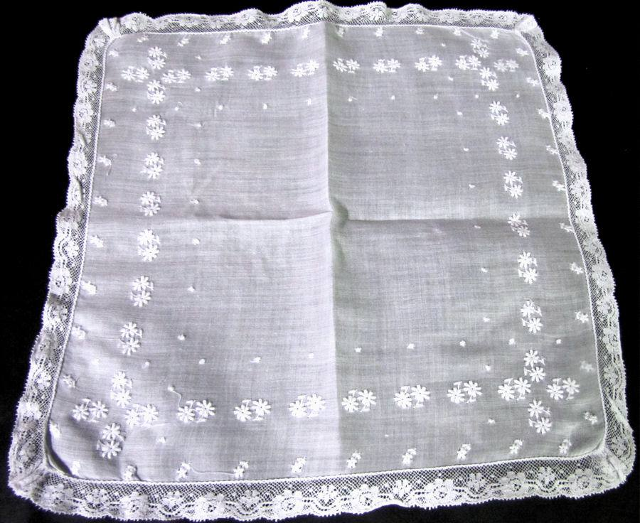 close up vintage antique wedding brides hanky french lace and whitework