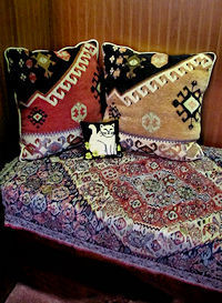 decorating antique chest with oriental textile and pillows     style=