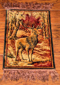 home decorating with antique silk textile deer rug