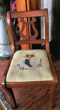 decorating the home with antique child's chair needlepoint